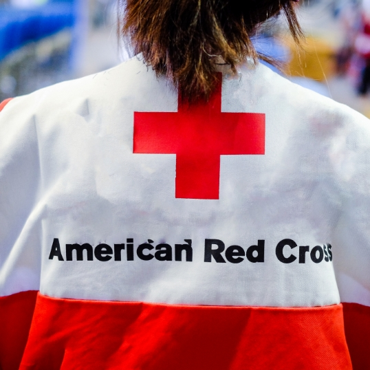 American red cross logo on person's jacket